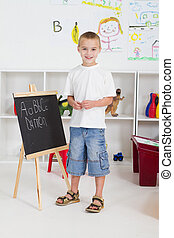 preschool boy in classroom
