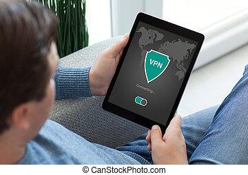 man holding tablet app vpn creation Internet protocols...