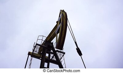 Small private yellow derrick pumps oil. - Small private...