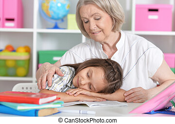 granny with her granddaughter, girl fall asleep