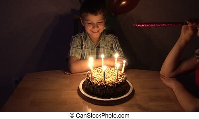 Boy celebrate his birthday with family and friends and...