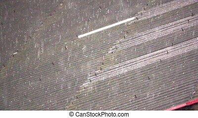 hailing over asbestos roof in super slow motion - Closeup...