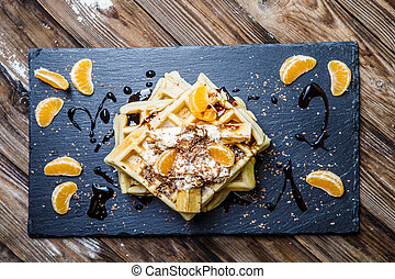 Viennese waffles on wooden table - Blackboard with Viennese...