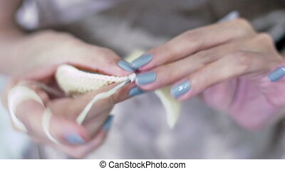 Close-up of young girl's hands crocheting - Soft focused...