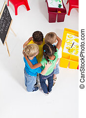 group of preschool kids huddle - overhead view of group of...