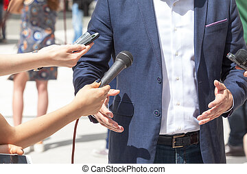 Media interview. Press conference. - Reporters making...
