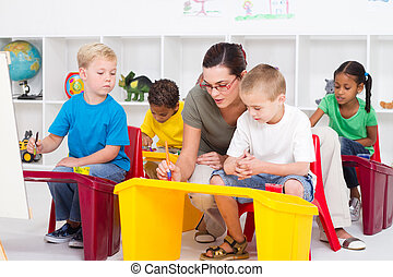 preschool students and teacher