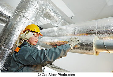female insulation worker - Thermal insulation. Female...