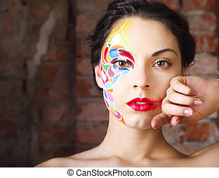 Portrait of a beautiful young model with bright make up