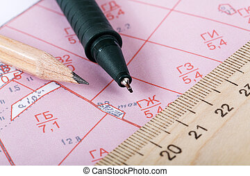 Topographic map of district with  ruler and a pencil