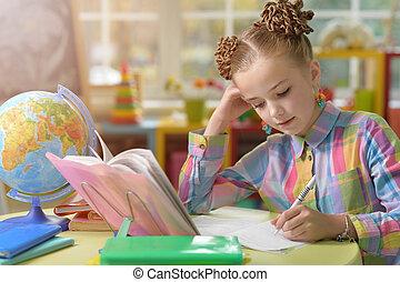 cute little girl doing lessons