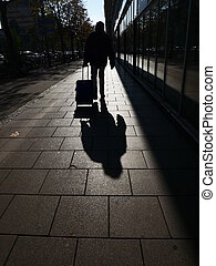person shadow town - Shadows of people walking in a street...