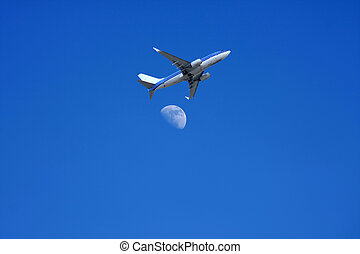 Jet plane flying over the moon