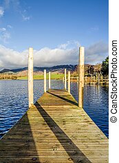 Wooden jetty on Derwentwater - A portrait view of a wooden...
