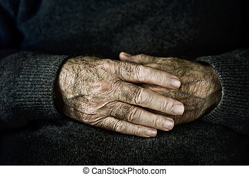 hands of an old caucasian man - closeup of the wrinkled...