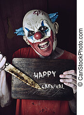 evil clown and text happy carnival - a scary evil clown...