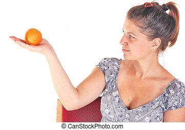 loosing weight - young female holding orange fruit isolated...