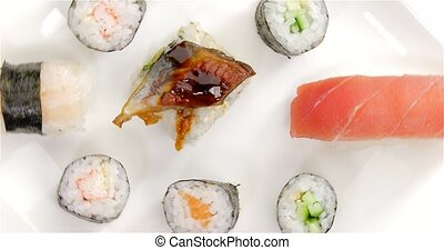Several japanese sushi pieces rotating - Several japanese...