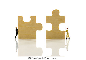 jigsaw puzzle isolated on white - miniature people solving...