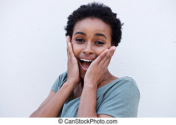 young black woman with surprised expression on face