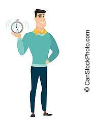 Caucasian business man holding alarm clock. - Caucasian...