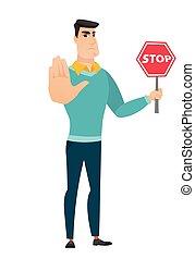 Caucasian businessman holding stop road sign. - Caucasian...