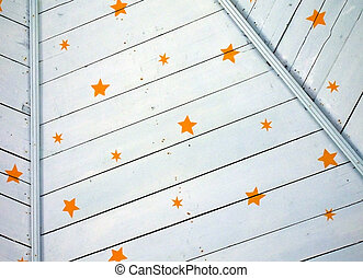 Stars on Wooden Ceiling - A detail of yellow stars on a...
