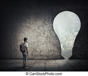 bulb doorway - Conceptual image with a person standing in a...