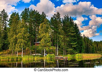 Wooden log cabin on the lake in Finland - Wooden cottage in...