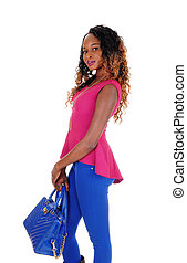 Beautiful tall woman with blue purse.