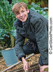 Happy Teenager Boy Male Young Adult Gardening