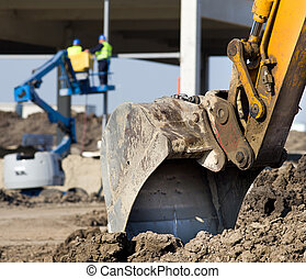 Excavator bucket at construction site - Close up of...