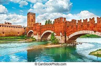 Bridge with archs Castelvecchio over river Adige in Verona...