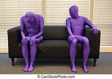 depression.anonymous men sitting on sofa in office, one is...