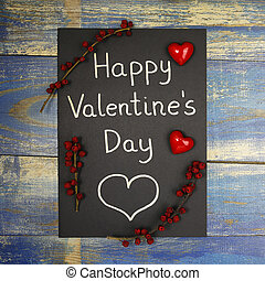 Happy Valentine's Day card decorated with red hearts and wild rose fruits