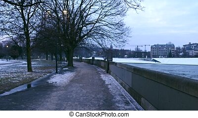 POV steadicam walk along Vistula river embankment in winter....