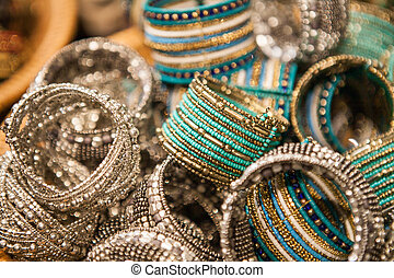 Close up of traditional indian bracelets on a market - Set...
