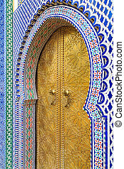 Entrance door with mosiac and brass door at the Royal palace...