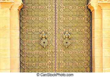Old entrance door at the Royal palace in Morocco Fes -...