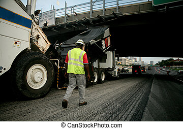 Road paving crew on interstate
