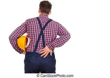 Young engineer having backpain - Picture of a young male...