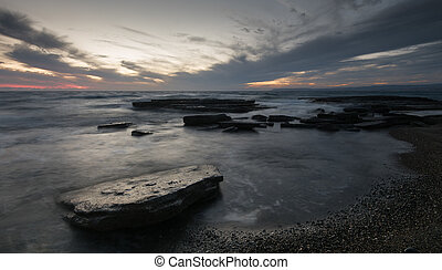 Sunset  on a rocky coastline