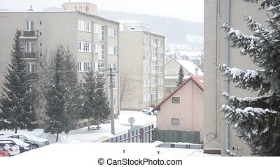 Part of the town in winter, it snows at street, flat houses,...