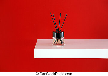 essential oil with sticks for flavoring