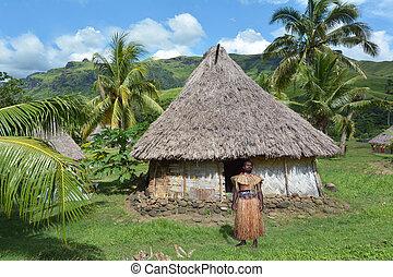 Indigenous Fijian man dressed in traditional Fijian costume,...