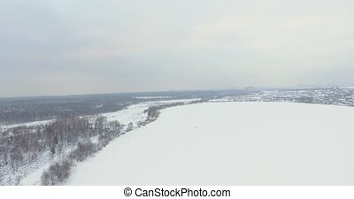 Flying over the snow-covered forest. - Shooting the drone...