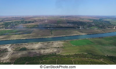 Aerial flight above vineyards and Danube river with...
