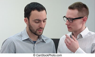 Two managers discussing contract in meeting room. Close up...