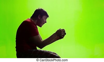 Man playing videogames. Slow otion. Green screen studio