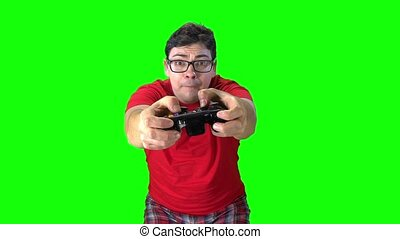 Man holding game controller playing videogames. Wind in the...